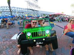 A couple enjoys a playful moment at Daytona International Speedway during Jeep Beach