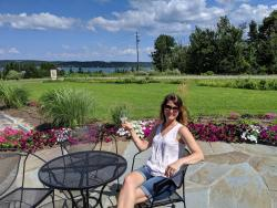 Stay awhile...enjoy a glass of wine on Bel Lago's Patio with stunning views of Lake Leelanau