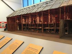 A model long house on display at the Seneca art and culture center at Ganondagan