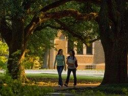 Students walking on campus at Rice University in Houston