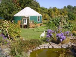 Climbing Vine Cottage—An elegant, ecologically friendly yurt that sleeps six, set on 18 acres amid a lush discovery garden.