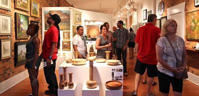 Visitors perusing art at a Short North gallery