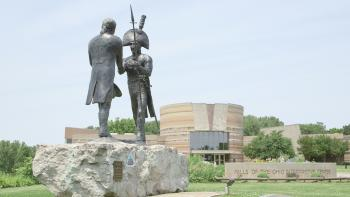 """""""When They Shook Hands"""" commemorative statue outside the Falls of the Ohio Interpretive Center."""