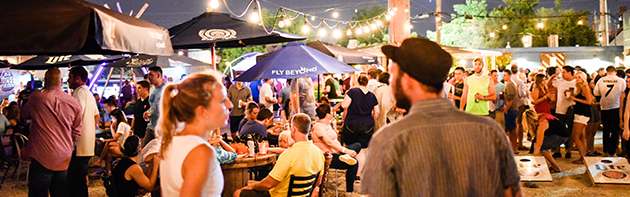 People at Bleu Garten, an outdoor patio bar in the Midtown District of Oklahoma City.