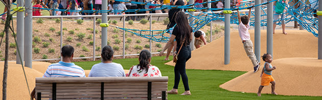 Families and children playing on playground at Oklahoma City's Scissortail Park
