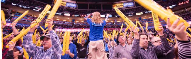 Crowd cheering on the Oklahoma City Thunder basketball team