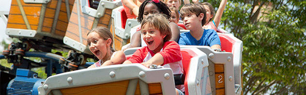Kids enjoying roller coaster