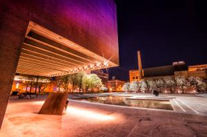 Purple Light Reflecting off Everson Museum At Night