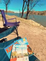 Kansas Travel Guides in a folding chair at Lake Scott State Park