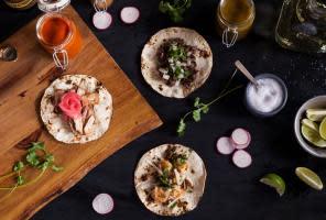 Shrimp & Chorizo Tacos, Jars of Hot Sauce and Ingredients from Moctezuma restaurant.