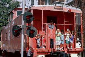 Wilmington, North Carolina railroad museum caboose with kids aboard