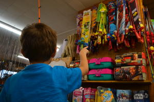 Kids pointing to toys at Schwartz's Bait & Tackle