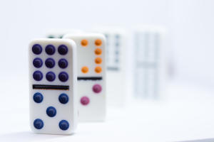 Close up of domino tiles: Game Nights at PGICA