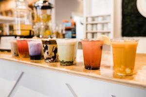 Different Cups Of Tea Lined Up At Fresco Tea Bar