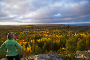 Woman Looking Out Over Hogback Mountain In Marquette, MI