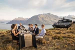 People Dining Outdoors beside Helicopter