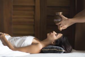 Woman Getting Shirodhara Treatment