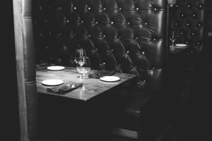 high-backed leather booth in black and white