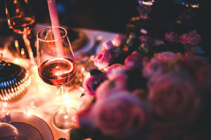 Glass of champagne and rose on table