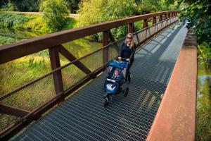 Mom and Baby Walking on Interurban Trail Bridge