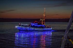 Morro Bay Lighted Boat cruising through water
