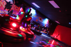 A crowd enjoys a round of bumper cars at the Roseland Family Fun Center