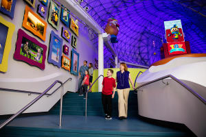 A family walks around inside of Strong National Museum of Play