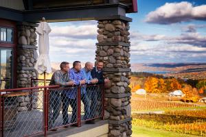 A group of men look out to the horizon near Keuka Lake