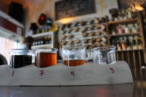 Cups sit in holders at Lake Drum brewing in Geneva