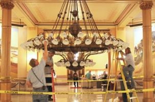 Changing light bulbs in rotunda chandelier Kansas Statehouse