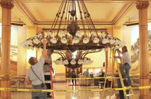 changing-light-bulbs in rotunda chandelier