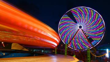 The Ferris wheel lights up the night at the New York State Fair