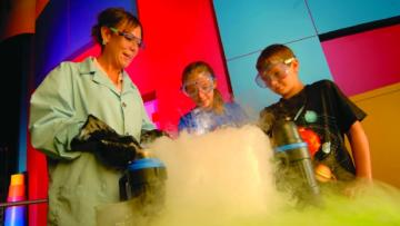 Kids watch a science experiment at the MOST in Syracuse, NY