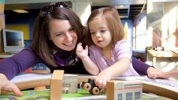 A mother and daughter play at the Rochester Museum & Science Center