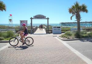 Riding a bike along the oceanfront in Kure Beach