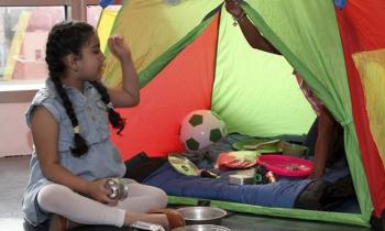 girl playing with tent inside
