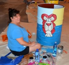 Photo of woman painting a drum