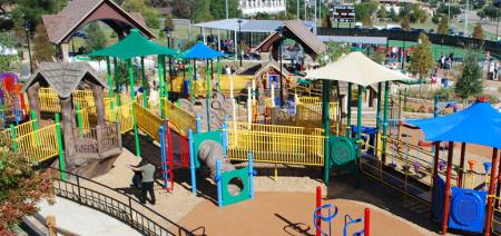 Brightly-colored playground equipment invites children to play at Cottonwood Creek Park.