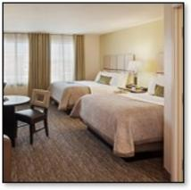 Candlewood Suites Dumfries - view of double beds and table