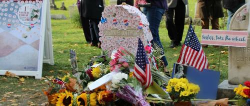 "Thousands cover Susan B. Anthony's grave in Rochester, NY with ""I Voted"" stickers."