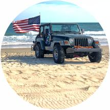 Jeep with American Flag on Outer Banks Beach