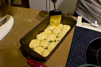 Brushing dough Balls with Butter