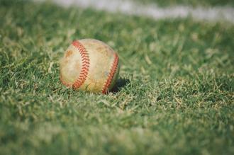 baseball in grass stock image