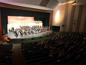 Indoor concert performance by symphony