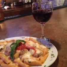 Plate Of Food With Red Wine At Bella Roma