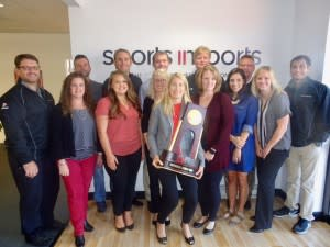 Sports Imports with NCAA Volleyball Trophy