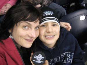 closeup of mom and son spectators at hockey game