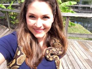 Nora wears a snake at Alligator Adventures