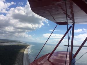A coastline view from a biplane
