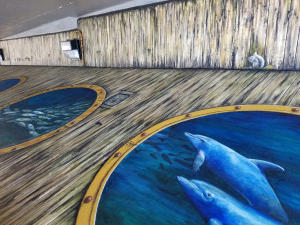"""Tails from the Harbor"" by Skip Dyrda and is the 30th mural in the Punta Gorda Historic Mural Society collection and will be dedicated June 20, 2019."
